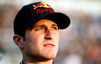 RICHMOND, VA - APRIL 30:  Kasey Kahne, driver of the #4 Red Bull Toyota stands on the grid before the NASCAR Sprint Cup Series Crown Royal Presents The Matthew & Daniel Hansen 400 at Richmond International Raceway on April 30, 2011 in Richmond, Virginia.