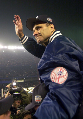 FLUSHING, NY - OCTOBER 26: (FILE PHOTO) Manager Joe Torre of the New York Yankees celebrates their 4-2 win and World Series Championship over the New York Mets in five games during the World Series October 26, 2000 at Shea Stadium in Flushing, New York.