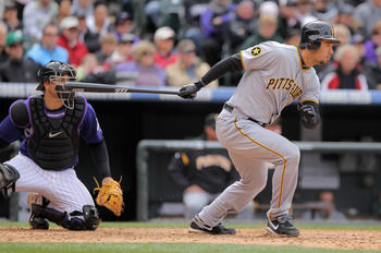 DENVER, CO - MAY 01:  Right fielder Garrett Jones #46 of the Pittsburgh Pirates takes an at bat as catcher Chris Iannetta #20 of the Colorado Rockies backs up the plate at Coors Field on May 1, 2011 in Denver, Colorado. The Pirates defeated the Rockies 8-