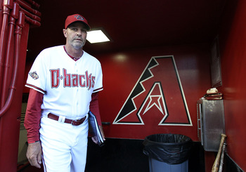PHOENIX, AZ - APRIL 12:  Manager Kirk Gibson of the Arizona Diamondbacks walks out into the dugout before the Major League Baseball game against the St. Louis Cardinals at Chase Field on April 12, 2011 in Phoenix, Arizona.  (Photo by Christian Petersen/Ge