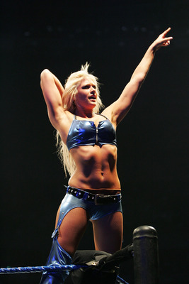 SYDNEY, AUSTRALIA - JUNE 15:  Kelly Kelly poses on the turnbuckle during WWE Smackdown at Acer Arena on June 15, 2008 in Sydney, Australia.  (Photo by Gaye Gerard/Getty Images)