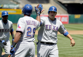 OAKLAND, CA - MAY 02:  Mitch Moreland #18 is congratulated by Adrian Beltre #29 of the Texas Rangers after he scored on a double by Michael Young #10 in the third inning against the Oakland Athletics at Oakland-Alameda County Coliseum on May 2, 2011 in Oa