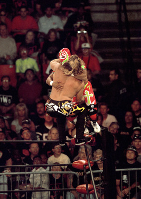 SAN DIEGO - JULY 12:  Jericho (front) defends his cruiserweight belt against Rey Mysterio Jr as they duke it out on the ropes during the WWE Bash at the Beach event at Cox Arena in San Diego, California on July 12, 1998. Mysterio became the new cruiserwei