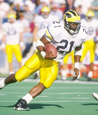 22 Oct 1994:  Running back Tim Biakabutaka of the Michigan Wolverines runs down the field during a game against the Illinois Fighting Illini at Memorial Stadium in Champaign, Illinios.  Michigan won the game 19-14. Mandatory Credit: Jonathan Daniel  /Alls