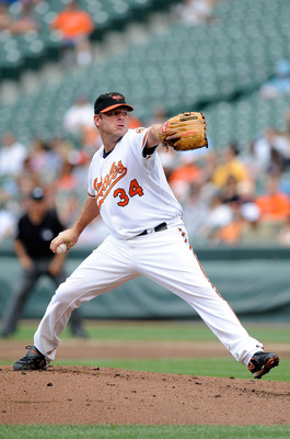 BALTIMORE - AUGUST 22:  Kevin Millwood #34 of the Baltimore Orioles pitches against the Texas Rangers at Camden Yards on August 22, 2010 in Baltimore, Maryland.  (Photo by Greg Fiume/Getty Images)