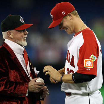 TORONTO, ON - MARCH 09:  Justin Morneau #22 of Canada signs an autograph for hockey broadcast legend Don Cherry during the 2009 World Baseball Classic Pool C game against Italy on March 9, 2009 at the Rogers Centre in Toronto, Ontario, Canada.  (Photo by
