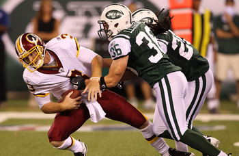 EAST RUTHERFORD, NJ - AUGUST 27:  Jim Leonhard #36 of the New York Jets sacks John Beck #3 of the Washington Redskins  during their preseason game on August 27, 2010 at the New Meadowlands Stadium  in East Rutherford, New Jersey.  (Photo by Al Bello/Getty