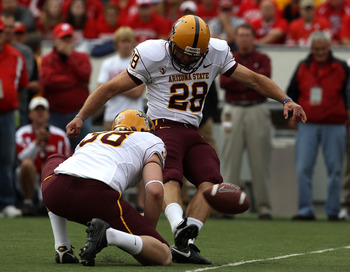 MADISON, WI - SEPTEMBER 18: Thomas Weber #28 of the Arizona State Sun Devils attempts a field goal out of the hold of Trevor Hawkins #38 against the Wisconsin Badgers at Camp Randall Stadium on September 18, 2010 in Madison, Wisconsin. Wisconsin defeated
