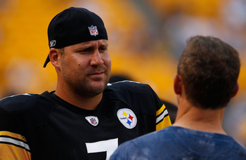 PITTSBURGH - AUGUST 14:  Ben Roethlisberger #7 of the Pittsburgh Steelers jokes around prior to the game with former Steeler Merril Hoge against the Detroit Lions on August 14, 2010 at Heinz Field in Pittsburgh, Pennsylvania. Steelers won 23-7.  (Photo by