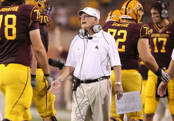 TEMPE, AZ - SEPTEMBER 04:  Head coach Dennis Erickson of the Arizona State Sun Devils congratulates teammates after the Sun Devils scored a touchdown during the college football game against the Portland State Vikings at Sun Devil Stadium on September 4,