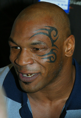 MEMPHIS, TN - FEBRUARY 20 :  Mike Tyson shows off his tattoo on his face on February 20, 2003 at his press conference for his fight against Clifford Etienne in Memphis, Tennessee. (Photo by Tom Casino/Getty Images)