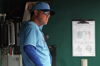 KANSAS CITY, MO - APRIL 17:  Manager Ned Yost #3 of the Kansas City Royals watches from the dugout during the game against the Seattle Mariners on April 17, 2011 at Kauffman Stadium in Kansas City, Missouri.  (Photo by Jamie Squire/Getty Images)