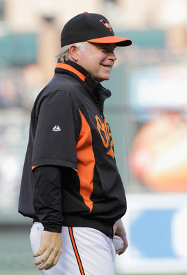 BALTIMORE, MD - APRIL 23:  Manager Buck Showalter #26 of the Baltimore Orioles before the start of their game against the New York Yankees at Oriole Park at Camden Yards on April 23, 2011 in Baltimore, Maryland.  (Photo by Rob Carr/Getty Images)
