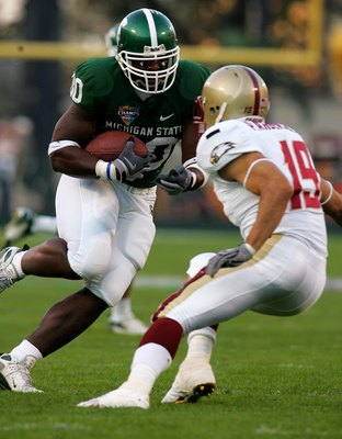 ORLANDO, FL - DECEMBER 28:  Jehuu Caulcrick #30 of the Michigan Sate Spartans is chased down by Paul Anderson #19 of the Boston College Eagles during the Champs Bowl on December 28, 2007 at the Citrus Bowl in Orlando, Florida.  (Photo by Sam Greenwood/Get