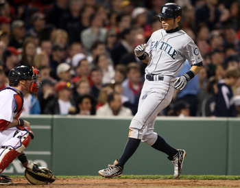 BOSTON, MA - APRIL 30:  Ichiro Suzuki #51 of the Seattle Mariners scores a run in the third inning against the Seattle Mariners Jarrod Saltalamacchia #39 of the Boston Red Sox defends on April 30, 2011 at Fenway Park in Boston, Massachusetts.  (Photo by E