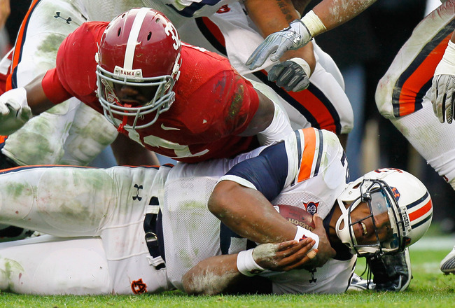TUSCALOOSA, AL - NOVEMBER 26:  Quarterback Cam Newton #2 of the Auburn Tigers dives on the ground for more yardage against C.J. Mosley #32 of the Alabama Crimson Tide at Bryant-Denny Stadium on November 26, 2010 in Tuscaloosa, Alabama.  (Photo by Kevin C.