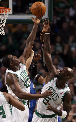 BOSTON, MA - FEBRUARY 06:  Kendrick Perkins #43 and Kevin Garnett #5 of the Boston Celtics fight for the rebound with Dwight Howard #12 of the Orlando Magic on February 6, 2011 at the TD Garden in Boston, Massachusetts. The Celtics defeated the Magic 91-8
