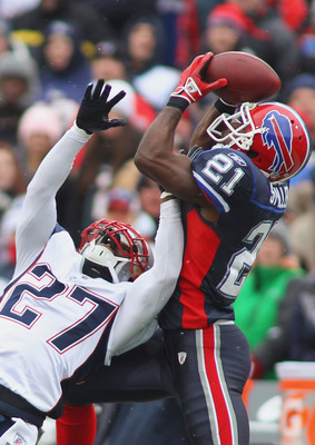 ORCHARD PARK, NY - DECEMBER 26:  C.J. Spiller #21  of the Buffalo Bills makes a catch against Kyle Arrington #27 of the New England Patriots at Ralph Wilson Stadium on December 26, 2010 in Orchard Park, New York. New England won 34-3. (Photo by Rick Stewa
