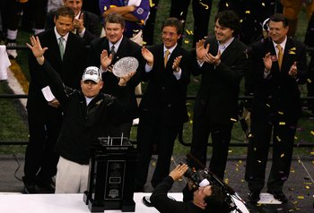 NEW ORLEANS - JANUARY 07:  Head coach Les Miles of the Louisiana State University Tigers celebrates with the championship trophy after defeating the Ohio State Buckeyes in the AllState BCS National Championship on January 7, 2008 at the Louisiana Superdom