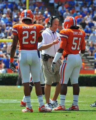 GAINESVILLE, FL - APRIL 9:  Linebackers coach D. J. Durkin of the Florida Gators directs play during the Orange and Blue spring football game April 9, 2011 Ben Hill Griffin Stadium at Gainesville, Florida.  (Photo by Al Messerschmidt/Getty Images)