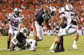 AUBURN, AL - SEPTEMBER 25:  Emory Blake #80 of the Auburn Tigers breaks a tackle by Rodney Paulk #45 of the South Carolina Gamecocks on the way to a touchdown at Jordan-Hare Stadium on September 25, 2010 in Auburn, Alabama.  (Photo by Kevin C. Cox/Getty I