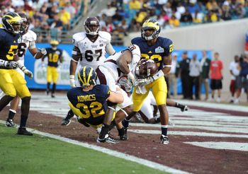 JACKSONVILLE, FL - JANUARY 01:  Running back Vick Ballard #28 of the Mississippi State Bulldogs rushes for a touchdown in the 3rd quarter against the Michigan Wolverines during the Gator Bowl at EverBank Field on January 1, 2011 in Jacksonville, Florida