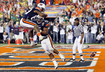GLENDALE, AZ - JANUARY 10:  Michael Dyer #5 of the Auburn Tigers celebrates with Darvin Adams #89 Tigers after Dyer runs the ball for 16-yards and is called down at the one-yardline with 10 seconds remaining in the fourth quarter against the Oregon Ducks