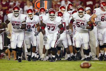 TUSCALOOSA, AL - SEPTEMBER 6: The Oklahoma Sooners offensive line emerges from a huddle against the Alabama Crimson Tide on September 6, 2003 in Tuscaloosa, Alabama. (Photo by Jamie Squire/Getty Images).