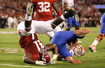 TUSCALOOSA, AL - OCTOBER 02:  Courtney Upshaw #41 of the Alabama Crimson Tide sacks quarterback John Brantley #12 of the Florida Gators at Bryant-Denny Stadium on October 2, 2010 in Tuscaloosa, Alabama.  (Photo by Kevin C. Cox/Getty Images)