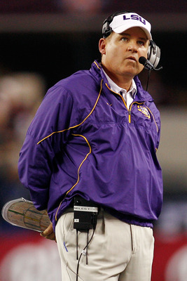 ARLINGTON, TX - JANUARY 07:  Head coach Les Miles of the Louisiana State University Tigers watches the score board during a timeout against the Texas A&M Aggies during the AT&T Cotton Bowl at Cowboys Stadium on January 7, 2011 in Arlington, Texas.  (Photo
