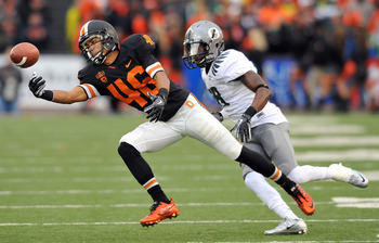 CORVALLIS, OR - DECEMBER 4: Aaron Nichols #46 of the Oregon State Beavers can't control the pass intended for him as Anthony Gildon #18 of the Oregon Ducks closes in during the fourth quarter of the game at Reser Stadium on December 4, 2010 in Corvallis,