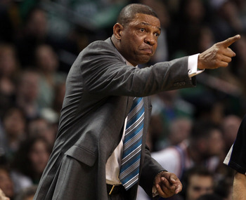 BOSTON, MA - APRIL 19:  Doc Rivers of the Boston Celtics directs his players in the second half against the New York Knicks in Game Two of the Eastern Conference Quarterfinals in the 2011 NBA Playoffs on April 19, 2011 at the TD Garden in Boston, Massachu
