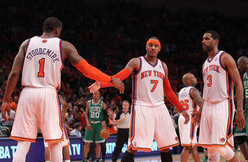 NEW YORK, NY - APRIL 24:  (L-R) Amar'e Stoudemire #1, Carmelo Anthony #7 and Shawne Williams #3 of the New York Knicks celebrate a play against the Boston Celtics in Game Four of the Eastern Conference Quarterfinals during the 2011 NBA Playoffs on April 2