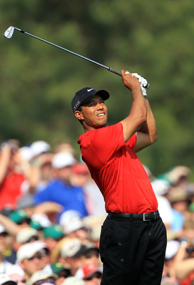 AUGUSTA, GA - APRIL 10:  Tiger Woods hits his tee shot on the 12th hole during the final round of the 2011 Masters Tournament at Augusta National Golf Club on April 10, 2011 in Augusta, Georgia.  (Photo by David Cannon/Getty Images)