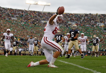 SOUTH BEND, IN - SEPTEMBER 25: Coby Fleener #82 of the Stanford Cardinal celebrates a touchdown catch against the Notre Dame Fighting Irish tries to defend at Notre Dame Stadium on September 25, 2010 in South Bend, Indiana. Standford defeated Notre Dame 3