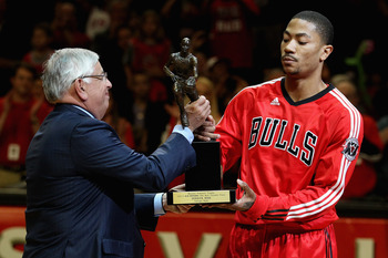 CHICAGO, IL - MAY 04: Derrick Rose #1 of the Chicago Bulls accepts the Maurice Podoloff Trophy awarded to the NBA Most Valuable Player from Commissoner David Stern before taking on the Atlanta Hawks in Game Two of the Eastern Conference Semifinals in the