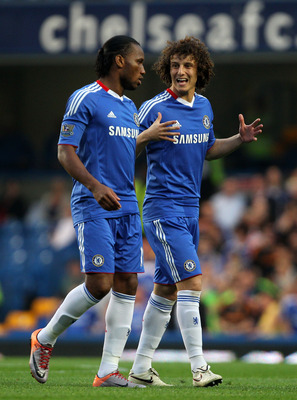 LONDON, ENGLAND - APRIL 20: David Luiz (R) and  Didier Drogba of Chelsea talk during the Barclays Premier League match between Chelsea and Birmingham City at Stamford Bridge on April 20, 2011 in London, England.  (Photo by Clive Rose/Getty Images)