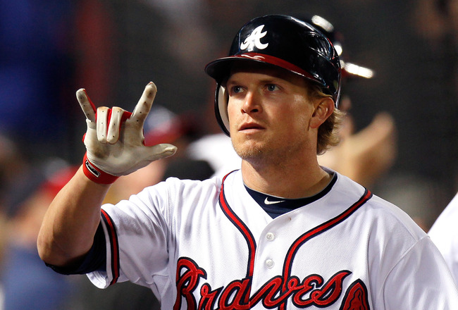 ATLANTA, GA - MAY 04:  Nate McLouth #13 of the Atlanta Braves reacts after hitting a two-run homer in the fourth inning against the Milwaukee Brewers at Turner Field on May 4, 2011 in Atlanta, Georgia.  (Photo by Kevin C. Cox/Getty Images)