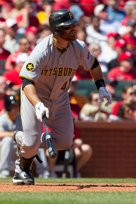 ST. LOUIS, MO - APRIL 6: Ryan Doumit #41 of the Pittsburgh Pirates hits an RBI single against the St. Louis Cardinals at Busch Stadium on April 6, 2011 in St. Louis, Missouri.  (Photo by Dilip Vishwanat/Getty Images)