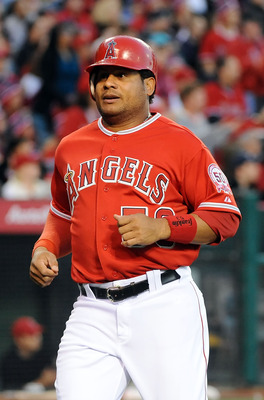 ANAHEIM, CA - APRIL 09:  Bobby Abreu #53 of Los Angeles Angels of Anaheim runs home to score in the third inning against the Toronto Blue Jays at Angel Stadium of Anaheim on April 9, 2011 in Anaheim, California.  (Photo by Lisa Blumenfeld/Getty Images)