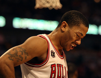 CHICAGO, IL - JANUARY 28: Derrick Rose #1 of the Chicago Bulls, playing in pain from an ulcer, reacts as walks to the free-throw line against the Orlando Magic at the United Center on January 28, 2011 in Chicago, Illinois. The Bulls defeated the Magic 99-