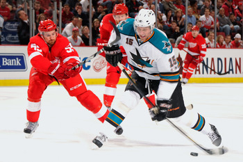 DETROIT - MAY 4:  Dany Heatley #15 of the San Jose Sharks unleashes a shot as Niklas Kronwall #55 of the Detroit Red Wings defends in the first period in Game Three of the Western Conference Semifinals during the 2011 NHL Stanley Cup Playoffs on May 4, 20