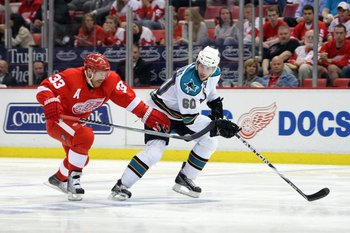 DETROIT - MAY 4:  Jason Demers #60 of the San Jose Sharks skates against Kris Draper #33 of the Detroit Red Wings in Game Three of the Western Conference Semifinals during the 2010 Stanley Cup Playoffs at Joe Louis Arena on May 4, 2010 in Detroit, Michiga