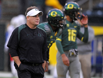 EUGENE, OR - NOVEMBER 26: Head coach Chip Kelly of the Oregon Ducks looks on as his team warms up before the game against the Arizona Wildcats at Autzen Stadium on November 26, 2010 in Eugene, Oregon. The Ducks won the game 48-29. (Photo by Steve Dykes/Ge