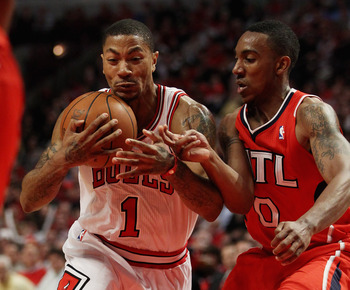 CHICAGO, IL - MAY 04: Derrick Rose #1 of the Chicago Bulls hangs on to the ball as he moves past Jeff Teague #0 of the Atlanta Hawks in Game Two of the Eastern Conference Semifinals in the 2011 NBA Playoffs at the United Center on May 4, 2011 in Chicago,
