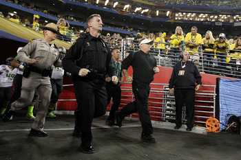 GLENDALE, AZ - JANUARY 10:  Head coach Chip Kelly of the Oregon Ducks takes the field during their 22-19 loss to the Auburn Tigers during the Tostitos BCS National Championship Game at University of Phoenix Stadium on January 10, 2011 in Glendale, Arizona