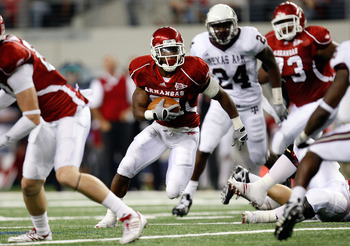 ARLINGTON, TX - OCTOBER 03:  Running back Michael Smith #21 of the Arkansas Razorbacks runs against the Texas A&M Aggies at Cowboys Stadium on October 3, 2009 in Arlington, Texas.  (Photo by Ronald Martinez/Getty Images)