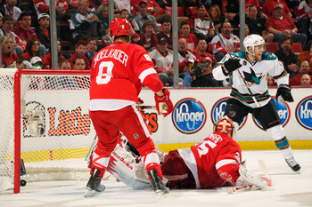 DETROIT - MAY 4:  Joe Pavelski #8 of the San Jose Sharks celebrates the game-tying goal in the third period by Dan Boyle #22 of the San Jose Sharks as goaltender Jimmy Howard #35 of the Detroit Red Wings and Justin Abdelkader #8 of the Detroit Red Wings w