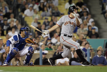 LOS ANGELES, CA - APRIL 01:  Brandon Belt #9 of the San Francisco Giants bats against the Los Angeles Dodgers at Dodger Stadium on April 1, 2011 in Los Angeles, California.  (Photo by Jeff Gross/Getty Images)