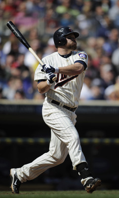 MINNEAPOLIS, MN - APRIL 24: Jason Kubel #16 of the Minnesota Twins hits a two-run double against the Cleveland Indians during the seventh inning of their game on April 24, 2011 at Target Field in Minneapolis, Minnesota. Twins defeated the Indians 4-3. (Ph